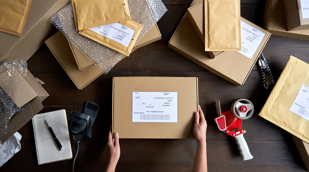 seller packing ecommerce shipping order box for dispatching