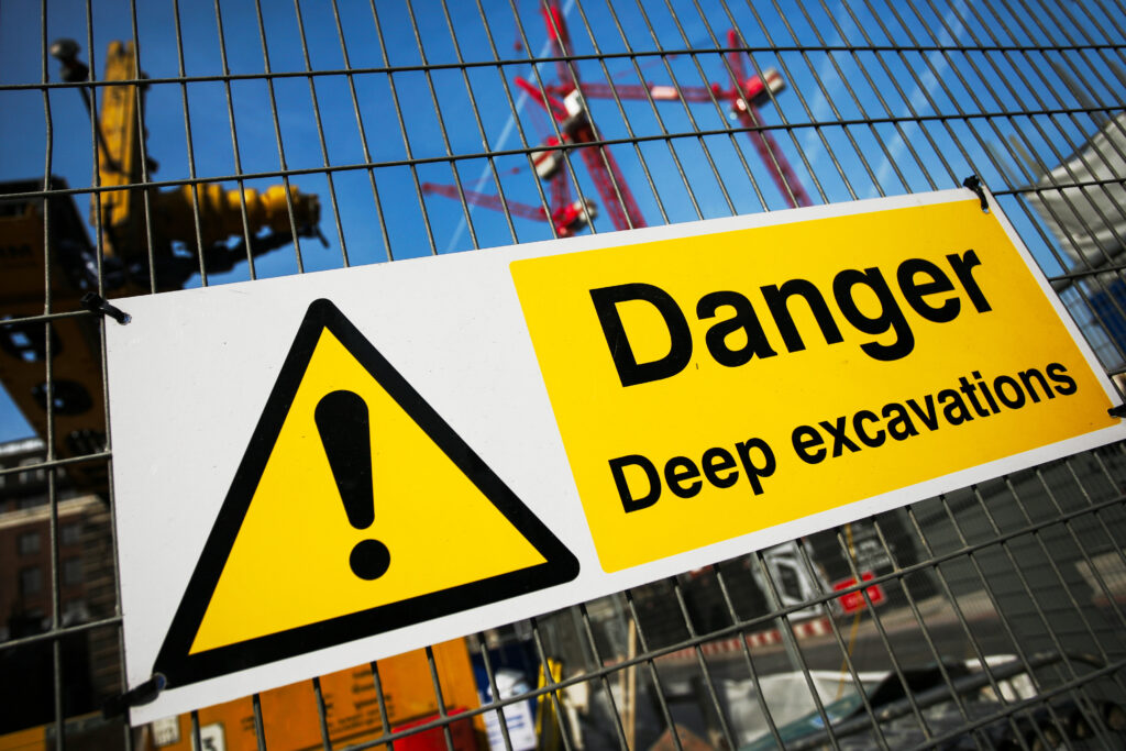 danger deep excavation customized warning signs in a construction site